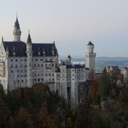 Neuschwanstein at dusk on a misty autumn evening.