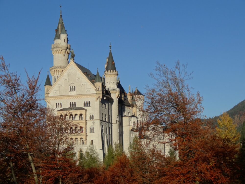 West side of castle Neuschwanstein in autumn.