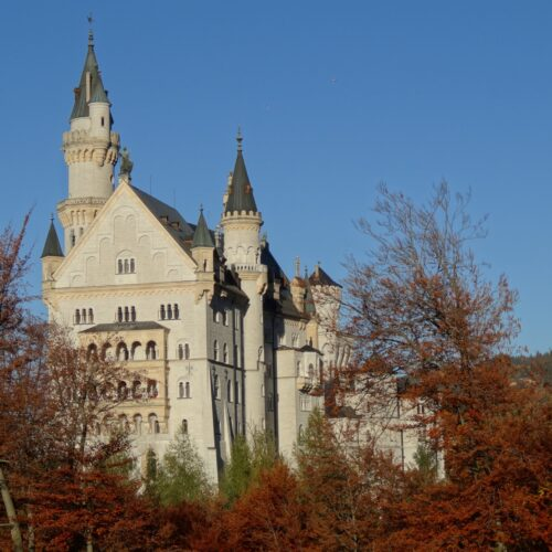 West side of castle Neuschwanstein in autumn.