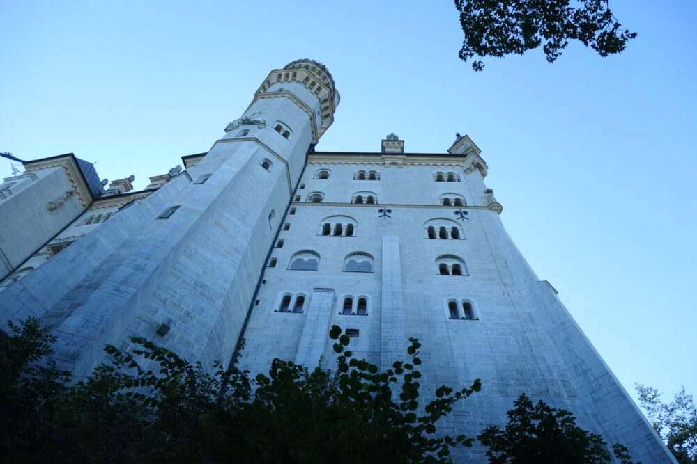 Looking up at the walls of castle Neuschwanstein on a cold autumn morning.