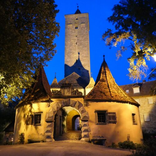 One of Rothenburg's city gates at night.