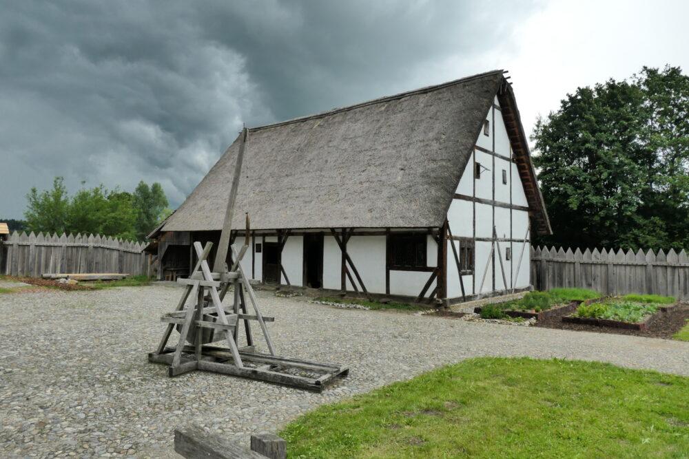 Trebuchet in front of a farm building
